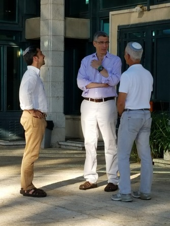 Rabbi Spilker (left) talks with Rabbi Rick Jacobs, president of the Union for Reform Judaism (center) and our guide, Zvi Levran, outside Kehillat Kol Haneshema, the Reform synagogue where we attended lively, musical Shabbat services.